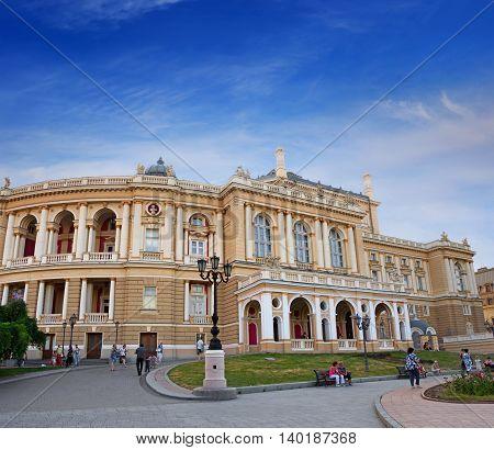 ODESSA UKRAINE - JUNE 26 2016: People walking on the territory of the Odessa Theatre of Opera and Ballet Ukraine