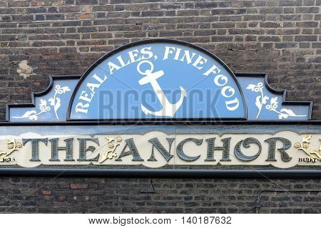 LONDON UK - JULY 1 2014: The Anchor Bankside is a pub in London on the South Bank of the Thames. A tavern establishment (under various names) has been at the pub's location for over 800 years.