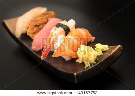 close up of sashimi sushi set on stone plate