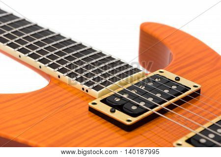 Detail of Orange Electric Guitar Body with Strings Isolated on White Background