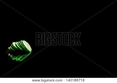 Sliced Cucumber Over Black