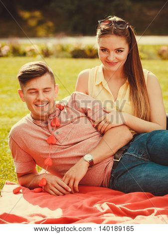 Romance valentines leisure concept. Boy with heart chain and girl. Young couple with love symbol spend time together in park.