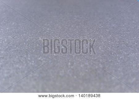 Selective focus grey textured background. Horizontal 3:2 format.