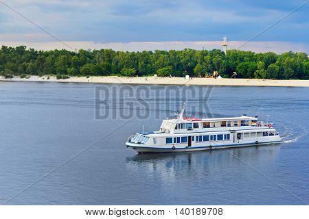 A touristic boat heading towards river port in Kiev Ukraine