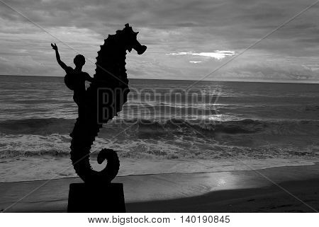 Seahorse sculpture on Los Muertos beach in sunset Puerto Vallarta Mexico. Black and white