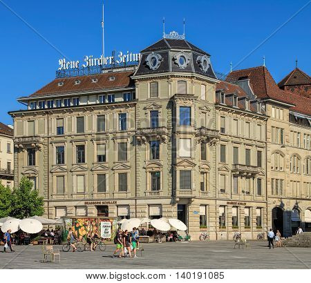 Zurich, Switzerland - 20 July, 2016: people and buildings on Sechselautenplatz square. Sechselautenplatz is a town square the largest one within the city of Zurich, it takes its name from the Sechselauten the city's traditional spring holiday.