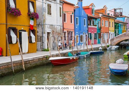 Colorful homes along a canal in Burano Italy