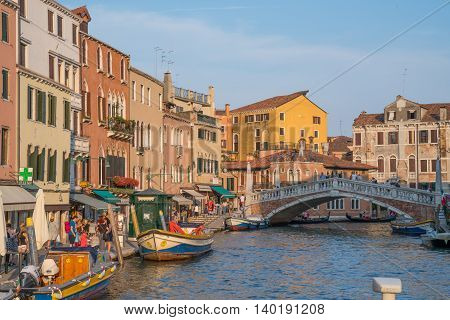 VENICE ITALY - JULY 2 2016: Canal in Venice Italy in late afternoon.
