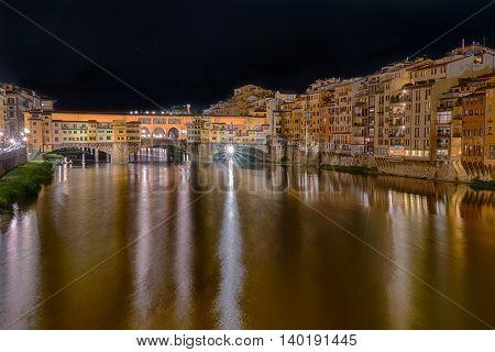 Ponte Vecchio along the Arno river in Florence Italy