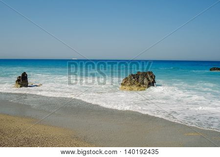 Megali Petra Is One Of The Popular Beaches In Lefkada Greece Huge Rocks In The Background