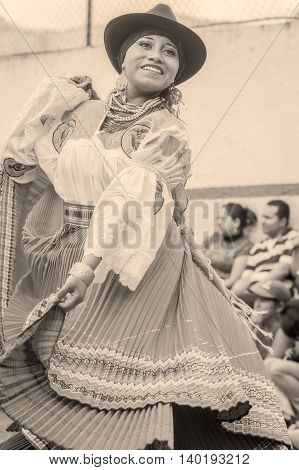 Banos De Agua Santa Ecuador - November 29 2014: Unidentified Youth Indigenous Woman Dancing On City Streets Of Banos De Agua Santa South America Monochrome Shoot