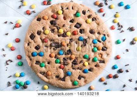 Colorful homemade chocolate chip cookie with bonbons