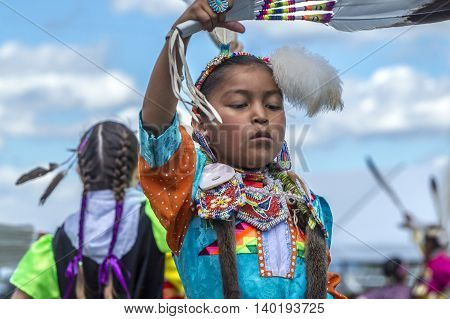 Coeur d'Alene Idaho USA - 07-23-2016. Native American girl at annual powwow. Young dancer participates in the Julyamsh Powwow on July 23 2016 at the Kootenai County Fairgrounds in Coeur d'Alene Idaho.