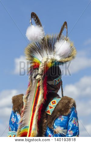 Coeur d'Alene Idaho USA - 07-23-2016. The back of a boy's headdress. Young dancer participates in the Julyamsh Powwow on July 23 2016 at the Kootenai County Fairgrounds in Coeur d'Alene Idaho.