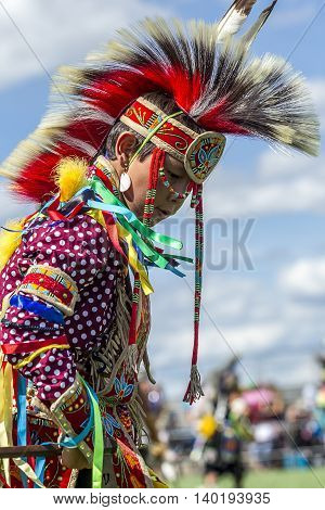 Coeur d'Alene Idaho USA - 07-23-2016. Young male dancer. Young dancer participates in the Julyamsh Powwow on July 23 2016 at the Kootenai County Fairgrounds in Coeur d'Alene Idaho.