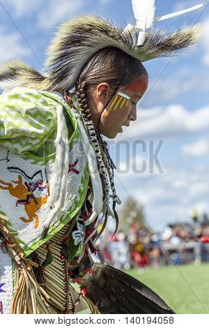 Coeur d'Alene Idaho USA - 07-23-2016. Close up of Native American boy. Young dancer participates in the Julyamsh Powwow on July 23 2016 at the Kootenai County Fairgrounds in Coeur d'Alene Idaho.