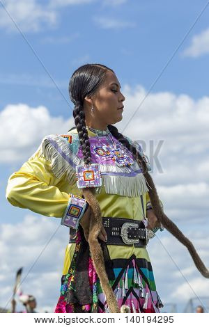 Coeur d'Alene Idaho USA - 07-23-2016. Young woman at Powwow. Young dancer participates in the Julyamsh Powwow on July 23 2016 at the Kootenai County Fairgrounds in Coeur d'Alene Idaho.