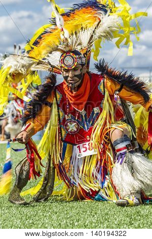 Coeur d'Alene Idaho USA - 07-23-2016. Close up of colorful traditional outfit. Young dancer participates in the Julyamsh Powwow on July 23 2016 at the Kootenai County Fairgrounds in Coeur d'Alene Idaho.
