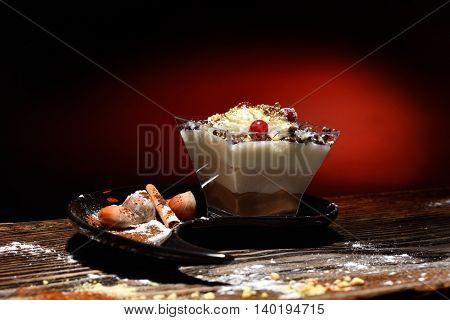 creamy cake on black plate