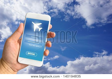 Woman hand holding smartphone against blur bokeh of airport background BOOK flights online concept