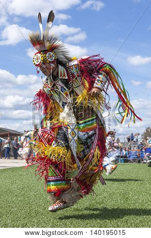 Coeur d'Alene Idaho USA - 07-23-2016. High stepping at the Julyamsh powwow. Young dancer participates in the Julyamsh Powwow on July 23 2016 at the Kootenai County Fairgrounds in Coeur d'Alene Idaho.