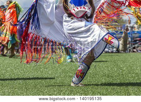 Close up of legs kicking it at powwow in Coeur d'Alene Idaho.