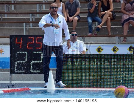 Budapest Hungary - Jul 14 2014. Ivica Tucak (head coach) talking to his team. The Waterpolo European Championship was held in Alfred Hajos Swimming Centre in 2014.