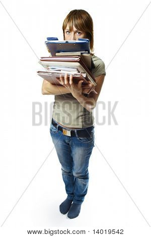 Young woman holding stack of papers over white background