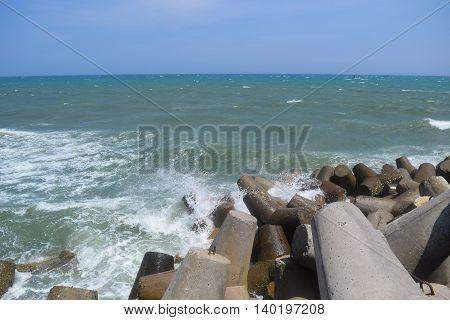 Concrete block tetrapod breakwater protect muine sea vietnam