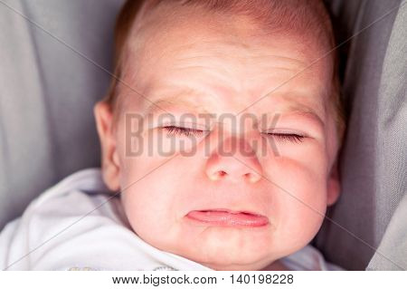 Portrait Of Cute 4-Month Baby Boy Crying