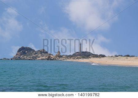 beautiful tropical beach with many rocks and historic lighthouse on small island in ke ga near muine vietnam