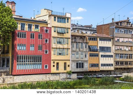 GIRONA SPAIN - JULY 6 2016: Colorful houses against blue sky in Girona Catalonia Spain