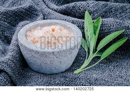 Himalayan Pink Salt In White Mortar With Sage Leaves On Dark Fabric Background. Himalayan Salt Commo