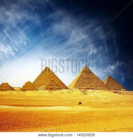 Great pyramids in Giza valley and rider on camel. Egypt