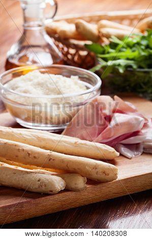 Italian Grissini With Ham Prosciutto, Mozzarella And Arugula