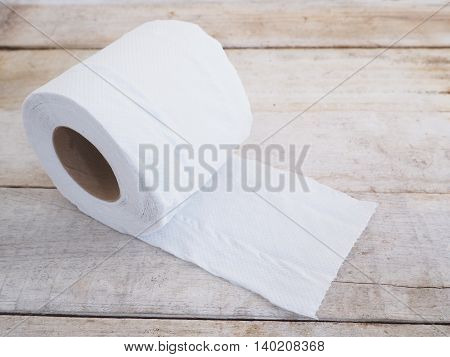 White tissue paper on old wooden background