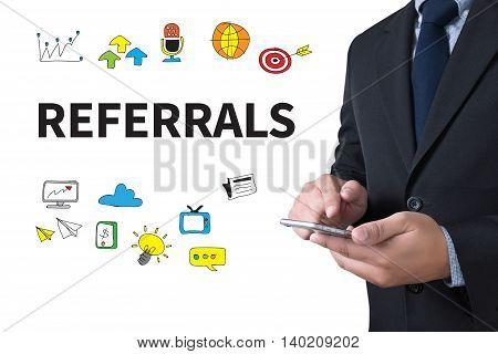 REFERRALS Business team hands at work computer top