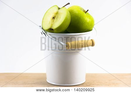 Green apple  in  white tank on wood and white background.Fruit for health and Hi-vitamin or food for health.1