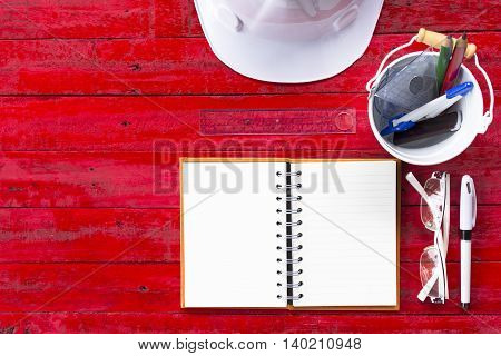 Architect tools  on wooden red table background or equipment for work daily of architect.001