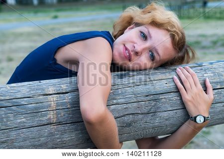 Young thoughtful woman with freckles outdoors in summer day