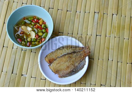 fish fry on dish dipping with chili sauce