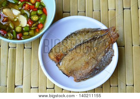 solid frying fish dipping with chili sauce