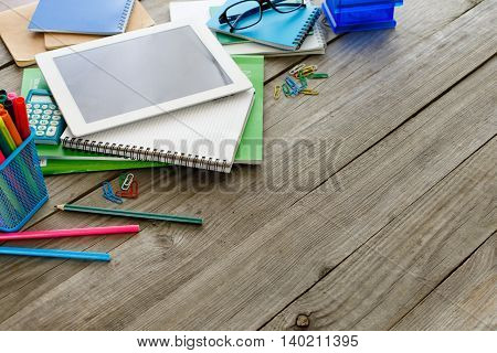 School different supplies on gray wooden table with copy space
