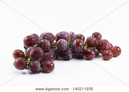 Red grape isolated on white background.Fruit for health and Hi-vitamin and Nourishing blood system.