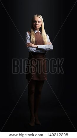 Close  up portrait of a business woman on black background