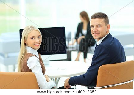 Happy business people looking at camera in office