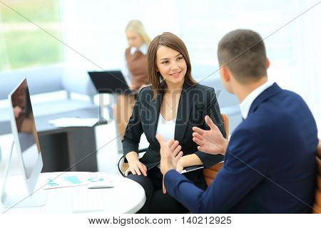 Smiling Business woman looking at her collegue while he explaini