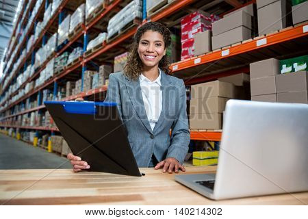 Business woman posing for the camera in a warehouse
