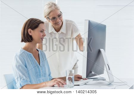 Pateint with doctor using computer at clinic