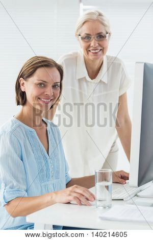 Portrait of smiling patient and doctor in clinic